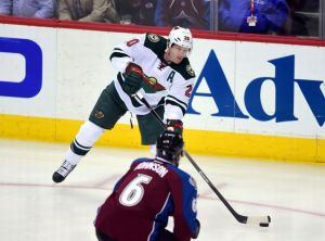 Minnesota Wild defenseman Ryan Suter makes a pass against the Avalnche