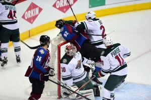 Minnesota Wild goalie Bryzgalov tries to escape as his crease becomes crowded in Game 2