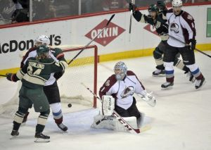 Minnesota Wild players celebrate a goal by Jared Spurgeon