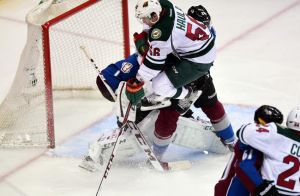 Minnesota Wild Erik Haula goes high in an attempt to score on Colorado's Varlamov