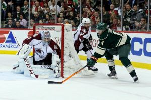 Minnesota Wild winger Zach Parise tries a wrap around shot on Avalanche goalie Varlamov