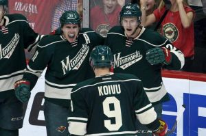 Minnesota Wild Captain Mikko Koivu celebrates with teammates during the Wild's win Monday night