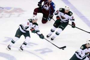 Minnesota Wild winger Zach Parise carries the puck up the ice against the Avalanche.