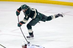 Minnesota Wild winger Zach Parise take a shot on Avalanche goalie Varlamov