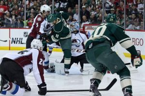 Minnesota Wild defenseman Ryan Suter shoots and Parise deflects the puck in for a goal Monday night