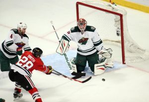 Minnesota Wild Goalie Ilya Bryzgalov make a save on Chicago's Ben Smith