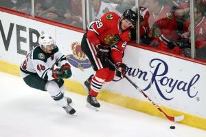 Minnesota Wild defenseman Jared Spurgeon gives Chicago's Bryan Bickell little room to work with.