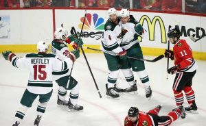 Minnesota Wild players celebrate Cody McCormick's goal in game 2