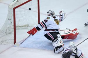 Minnesota Wild forward Mikael Granlund (not pictured) scores on Chicago goalie Crawford