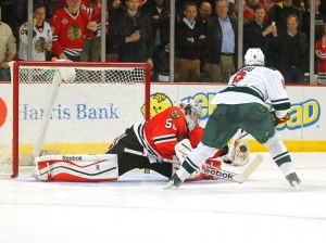 Minnesota Wild Captain Mikko Koivu tries to score on Corey Crawford