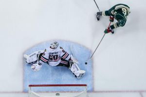 Minnesota Wild forward Erik haula scores the game winning goal on Chicago goalie Crawford