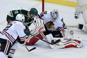 Minnesota Wild forward Zach takes a shot on Chicago goalie Crawford