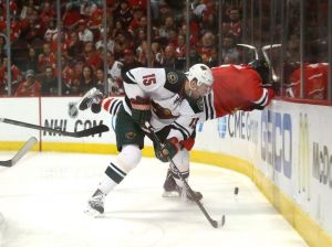 Minnesota Wild forward Dany Heatley avoids a flying Blackhawks Brent Seabrook in game 5