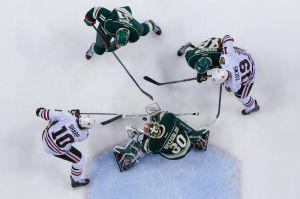 Minnesota Wild goalie Ilya Bryzgalov make a save in his shutout win over Chicago in game three.