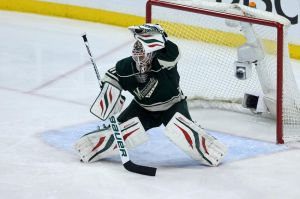 Minnesota Wild goalie Bryzgalov makes a save against the Blackhawks