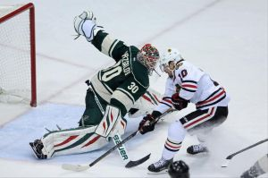 """Minnesota Wild goalie Ilya Bryzgalov make a big save on a Patrick Sharp breakaway."