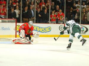 Minnesota Wild forward jason Pominville tries to put a shot past Blackhawks goalie Corey Crawford in game 2