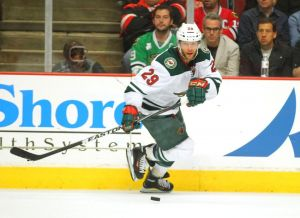Minnesota Wild forward Jason Pominville carries the puck up ice