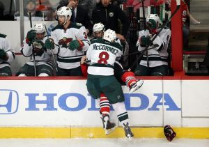 Minnesota Wild forward Cody McCormick makes a hit during his teams game two loss to Chicago