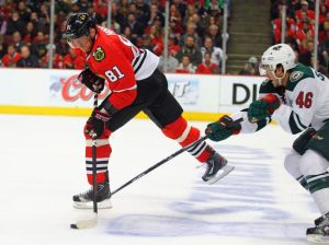 Minnesota Wild defenseman Jared Spurgeon battles for the puck with Marian Hossa