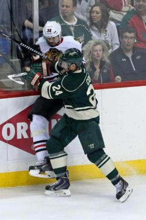 Minnesota Wild agitator Matt Cooke makes a big hit on a Blackhawks player in game 4