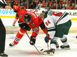 Minnesota Wild forward Mikael Granlund battles for control of a faceoff
