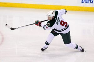 Minnesota Wild Captain Mikko Koivu lets a shot fly on Blackhawks goalie Crawford