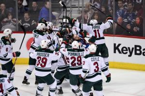 Minnesota Wild players mob Nino Niederreiter after his game winning goal in overtime.