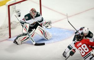 """Minnesota Wild goalie Ilya Bryzgalov makes another big save on Chicago's Patrick Kane."