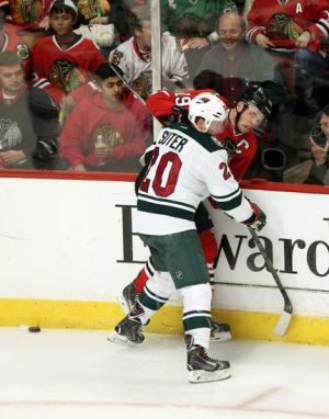 Minnesota Wild defenseman Ryan Suter hits Chicago Captain Jonathan Toews during game 2