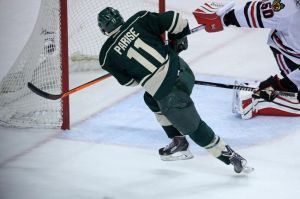 Minnesota Wild wing Zach Parise scores on Blackhawks goalie Crawford