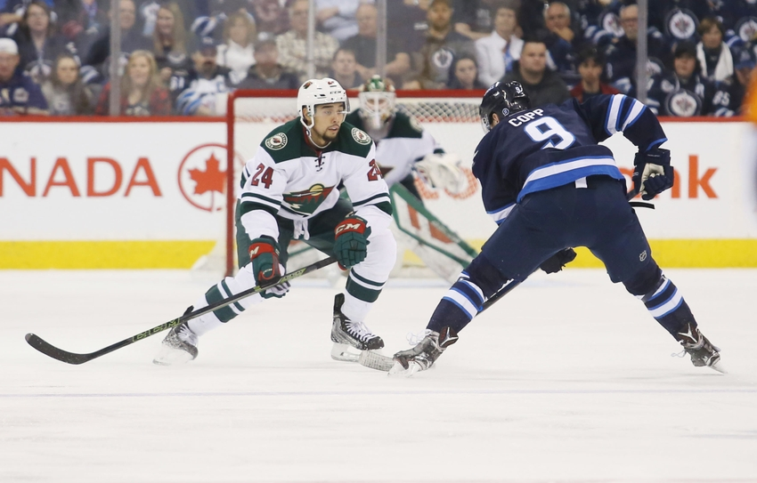 9227558-nhl-minnesota-wild-winnipeg-jets