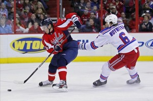 December 28, 2011; Washington, DC, USA; Washington Capitals left wing Alexander Semin (28) skates with the puck as New York Rangers defenseman Jeff Woywitka (6) chases in the second period at Verizon Center. Mandatory Credit: Geoff Burke-US PRESSWIRE