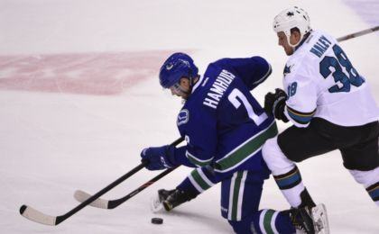 Mar 29, 2016; Vancouver, British Columbia, CAN; Vancouver Canucks defenseman Dan Hamhuis (2) defends San Jose Sharks forward Micheal Haley (38) during the second period at Rogers Arena. Mandatory Credit: Anne-Marie Sorvin-USA TODAY Sports