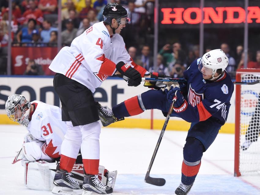 9554724-jay-bouwmeester-t.j.-oshie-hockey-world-cup-of-hockey-team-canada-vs-team-usa