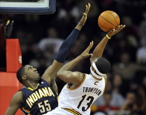 Dec 21, 2012; Cleveland, OH, USA; Indiana Pacers center Roy Hibbert (55) defends a shot by Cleveland Cavaliers power forward Tristan Thompson (13) in the fourth quarter at Quicken Loans Arena. Mandatory Credit: David Richard-USA TODAY Sports