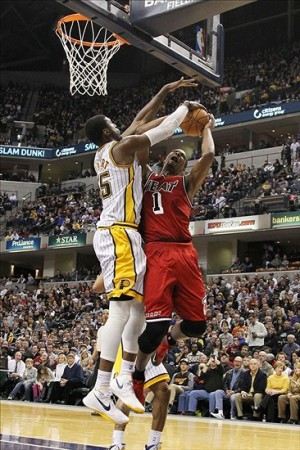 Feb 1 2013; Indianapolis, IN, USA; Miami Heat center Chris Bosh (1) has his shot blocked by Indiana Pacers center Roy Hibbert (55) at Bankers Life Fieldhouse. Indiana defeats Miami 102-89. Mandatory Credit: Brian Spurlock-USA TODAY Sports