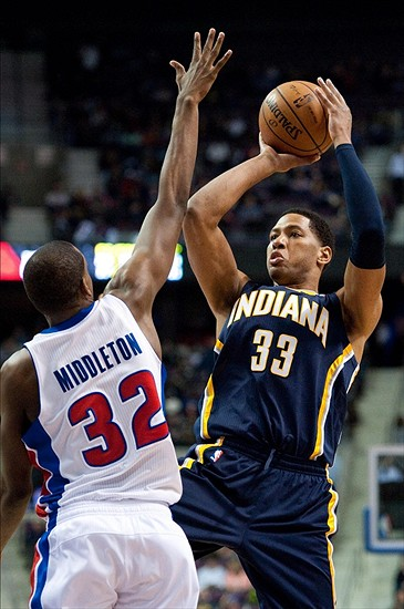 Feb 23, 2013; Auburn Hills, MI, USA; Indiana Pacers small forward Danny Granger (33) shoots over Detroit Pistons small forward Khris Middleton (32) during the fourth quarter at The Palace. Pacers win 90-72. Mandatory Credit: Tim Fuller-USA TODAY Sports
