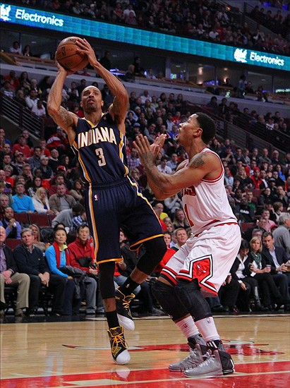 Nov 16, 2013; Chicago, IL, USA; Indiana Pacers point guard George Hill (3) shoots over Chicago Bulls point guard Derrick Rose (1) during the first quarter at the United Center. Mandatory Credit: Dennis Wierzbicki-USA TODAY Sports