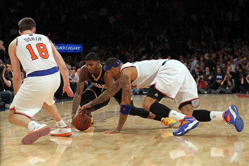Nov 20, 2013; New York, NY, USA; Indiana Pacers small forward Paul George (24) and New York Knicks power forward Kenyon Martin (3) scramble for a loose ball in front of Knicks point guard Beno Udrih (18) during the overtime period at Madison Square Garden. The Pacers defeated the Knicks 103-96 in overtime. Mandatory Credit: Brad Penner-USA TODAY Sports