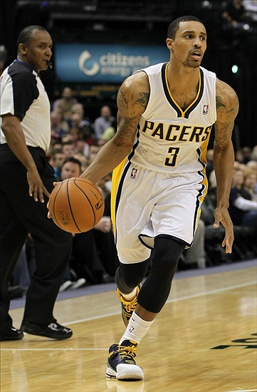 Nov 25, 2013; Indianapolis, IN, USA; Indiana Pacers point guard George Hill (3) dribbles the ball during the fourth quarter against the Minnesota Timberwolves at Bankers Life Fieldhouse. The Pacers won 98-84. Mandatory Credit: Pat Lovell-USA TODAY Sports