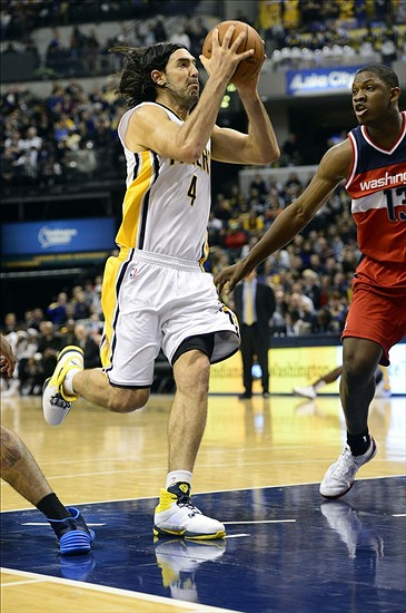 Nov 29, 2013; Indianapolis, IN, USA; Indiana Pacers power forward Luis Scola (4) makes a drive towards the basket during the second half of the game at Bankers Life Fieldhouse. Indiana Pacers win 93 to 73. Mandatory Credit: Marc Lebryk-USA TODAY Sports
