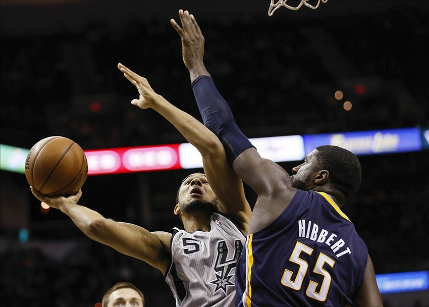 Dec 7, 2013; San Antonio, TX, USA; San Antonio Spurs guard Cory Joseph (5) drives to the basket as Indiana Pacers center Roy Hibbert (55) defends during the second half at AT