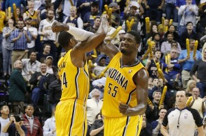Dec 20, 2013; Indianapolis, IN, USA; Indiana Pacers forward Paul George (24) celebrates with center Roy Hibbert (55) after a reverse dunk against the Houston Rockets at Bankers Life Fieldhouse. Indiana defeats Houston 114-81. Mandatory Credit: Brian Spurlock-USA TODAY Sports