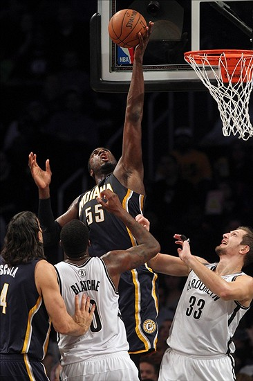 Dec 23, 2013; Brooklyn, NY, USA; Indiana Pacers center Roy Hibbert (55) grabs a rebound in front of Brooklyn Nets center Andray Blatche (0) and Brooklyn Nets power forward Mirza Teletovic (33) during the first quarter of a game at Barclays Center. Mandatory Credit: Brad Penner-USA TODAY Sports