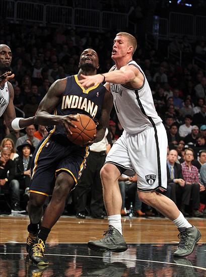 Dec 23, 2013; Brooklyn, NY, USA; Indiana Pacers shooting guard Lance Stephenson (1) drives to the basket past Brooklyn Nets power forward Mason Plumlee (1) during the second quarter of a game at Barclays Center. The Pacers defeated the Nets 103-86. Mandatory Credit: Brad Penner-USA TODAY Sports