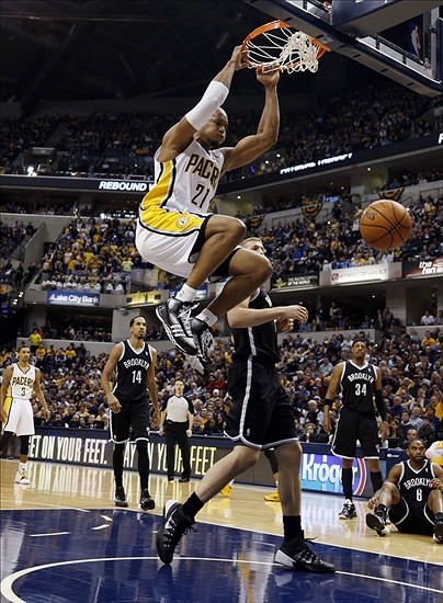 Dec 28, 2013; Indianapolis, IN, USA; Indiana Pacers forward David West (21) dunks against Brooklyn Nets center Mason Plumlee (1) at Bankers Life Fieldhouse. Indiana defeats Brooklyn 105-91. Mandatory Credit: Brian Spurlock-USA TODAY Sports