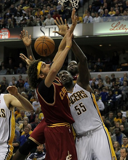 Dec 31, 2013; Indianapolis, IN, USA; Cleveland Cavaliers center Anderson Varejao (17) and Indiana Pacers center Roy Hibbert (55) battle for a rebound during the fourth quarter at Bankers Life Fieldhouse. The Pacers won 91-76. Mandatory Credit: Pat Lovell-USA TODAY Sports