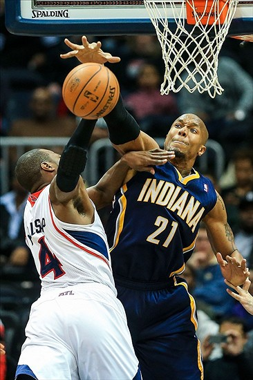Jan 8, 2014; Atlanta, GA, USA; Indiana Pacers power forward David West (21) blocks a shot by Atlanta Hawks power forward Paul Millsap (4) in the second half at Philips Arena. The Hawks won 97-87. Mandatory Credit: Daniel Shirey-USA TODAY Sports