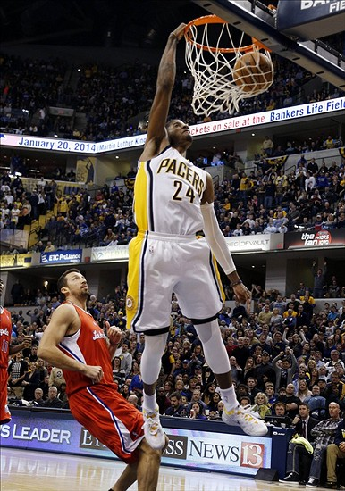 Jan 18, 2014; Indianapolis, IN, USA; Indiana Pacers forward Paul George (24) dunks on a break away against the Los Angeles Clippers at Bankers Life Fieldhouse. Indiana defeats Los Angeles 106-92. Mandatory Credit: Brian Spurlock-USA TODAY Sports